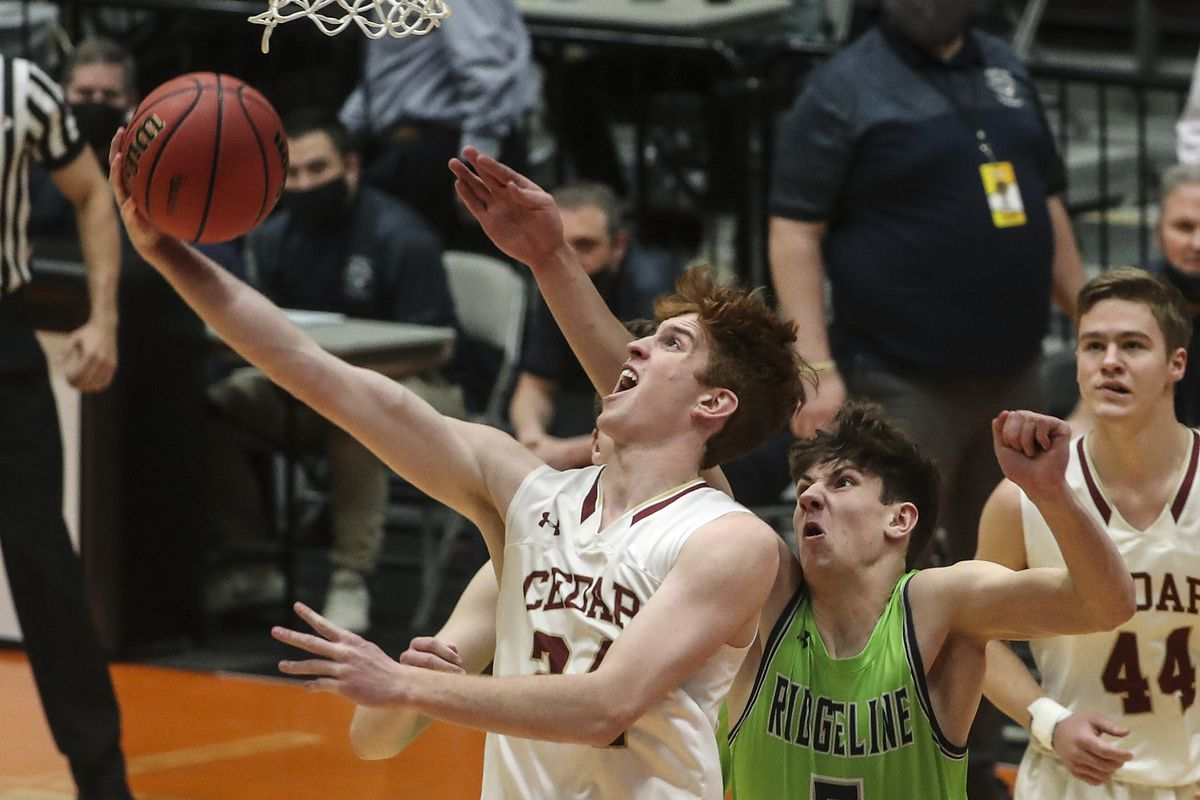 Cedar's Dallin Grant stretches for the basket after getting past Ridgeline's Peyton Knowles during the 4A boys basketball semifinal game between and at the Sevier Valley Center in Richfield on Tuesday, March 2, 2021.