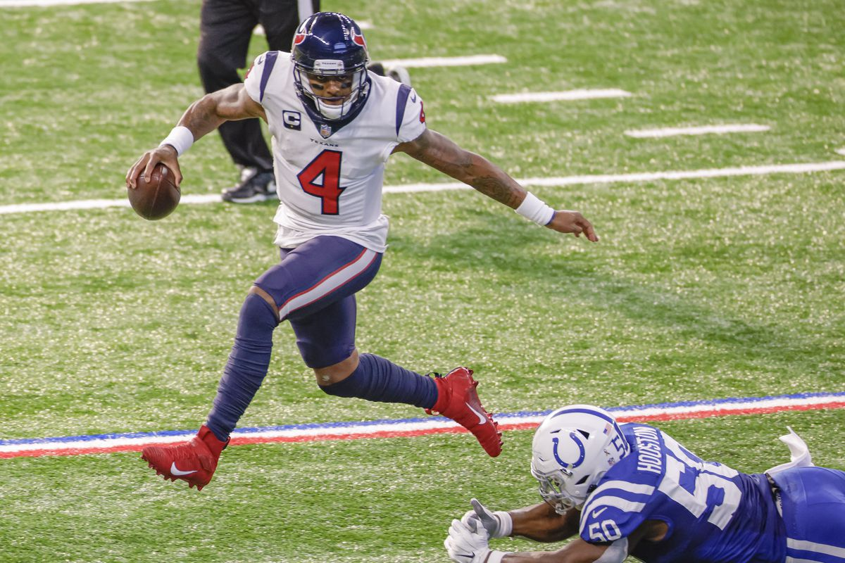 Deshaun Watson #4 of the Houston Texans runs the ball as Justin Houston #50 of the Indianapolis Colts attempts the tackle during the game at Lucas Oil Stadium on December 20, 2020 in Indianapolis, Indiana.