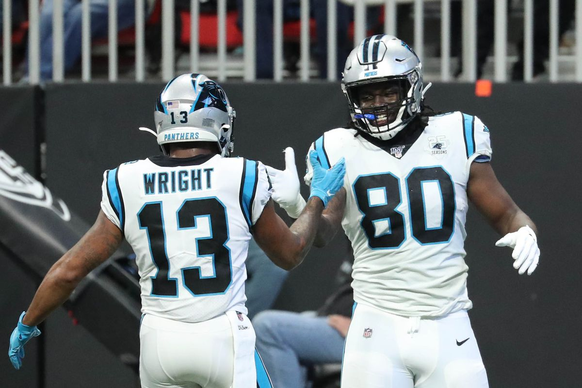 Carolina Panthers tight end Ian Thomas celebrates his touchdown with wide receiver Jarius Wright in the second quarter against the Atlanta Falcons at Mercedes-Benz Stadium.