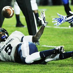 Utah State Aggies wide receiver JoJo Natson (9) makes a spectacular catch against Brigham Young Cougars in Provo Friday, Oct. 3, 2014.