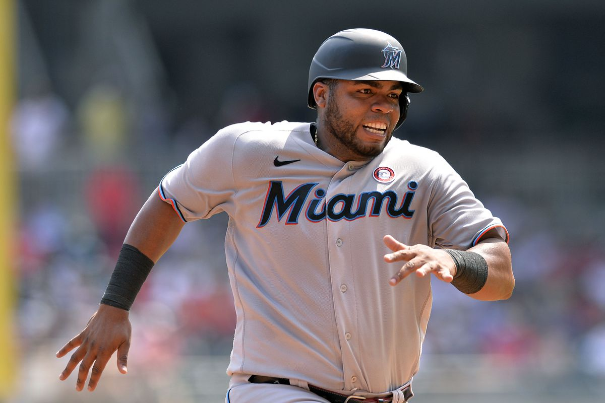 Jesús Aguilar #24 of the Miami Marlins runs toward home plate during a game against the Atlanta Braves at Truist Park