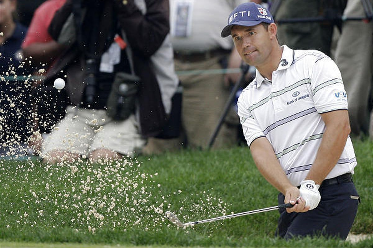 Padraig Harrington blasts from the sand on Saturday as he built a three-shot lead for the final day at Bridgestone.