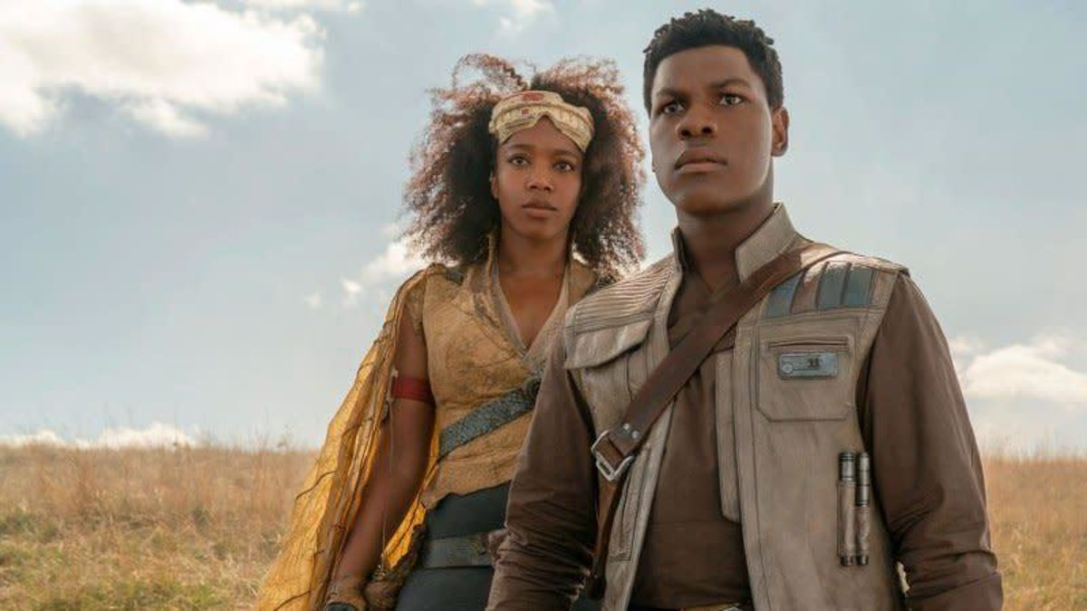 jannah and finn stand on the endor moon looking out at something