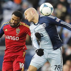Real's Robbie Findley and Sporting's Aurelien Collin battle for the ball as Real Salt Lake and Sporting KC play Saturday, Dec. 7, 2013 in MLS Cup action.