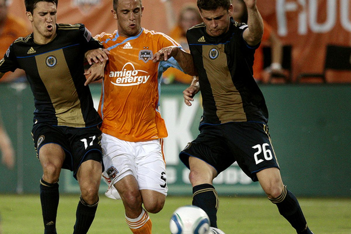 HOUSTON - MAY 29:  Danny Cruz #5 of the Houston Dynamo attempts to squeeze between Shea Salinas ,left, and Cristian Arrieta #26 of the Philadelphia Union at Robertson Stadium on May 29, 2010 in Houston, Texas.  (Photo by Bob Levey/Getty Images)