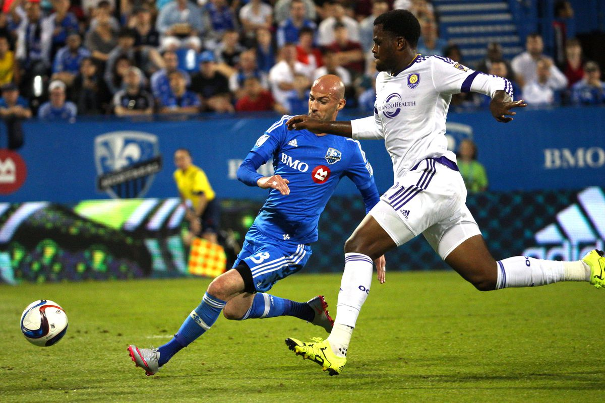 Ciman intervenes with a well-timed, sliding tackle in IMFC's 2-0 win Saturday over OCSC.