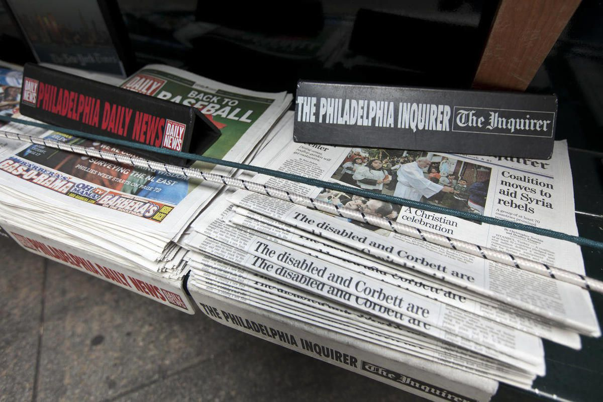 The Philadelphia Inquirer and Philadelphia Daily News newspapers sit on display on a newsstand, Monday, April 2, 2012, in Philadelphia. Philadelphia's two largest newspapers could trade hands Monday for the fifth time in six years. Several powerful local