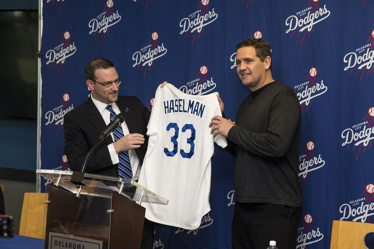 New Oklahoma City Dodgers manager Bill Haselman (right) is introduced by OKC general manager Michael Byrnes.
