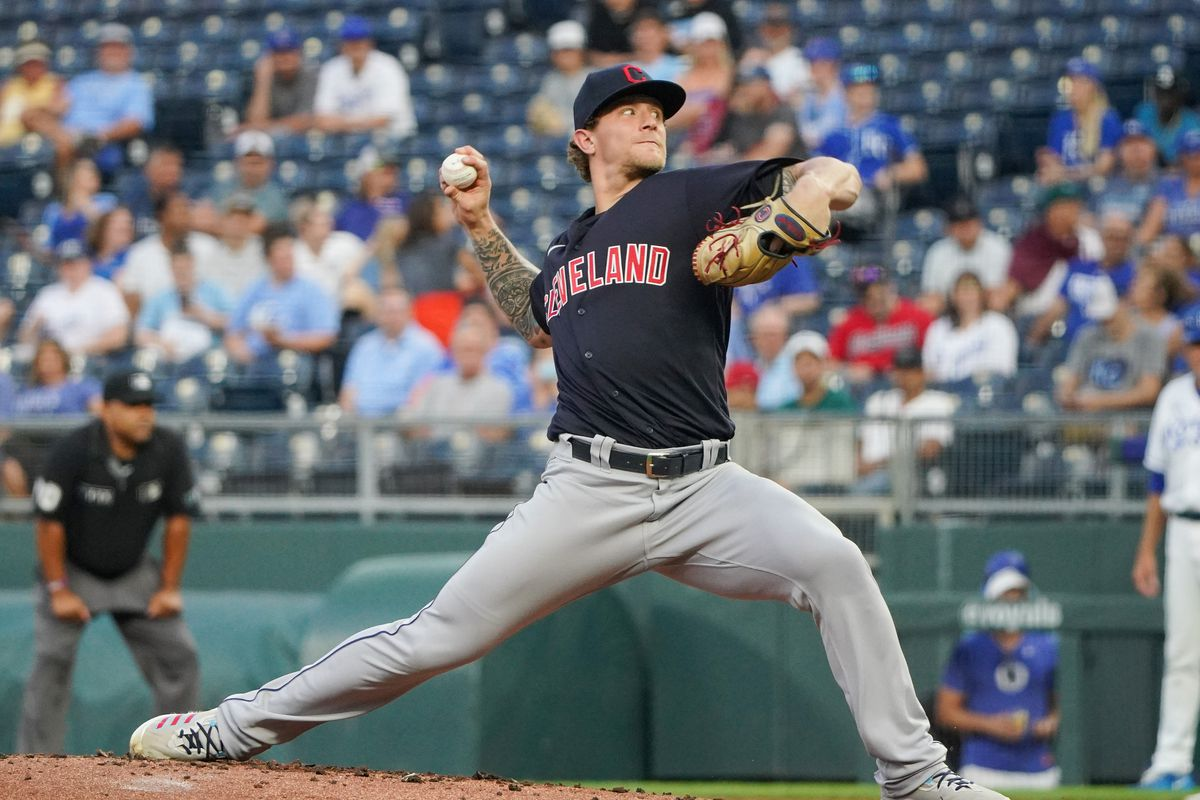 Cleveland Indians starting pitcher Zach Plesac (34) delivers against the Kansas City Royals at Kauffman Stadium.