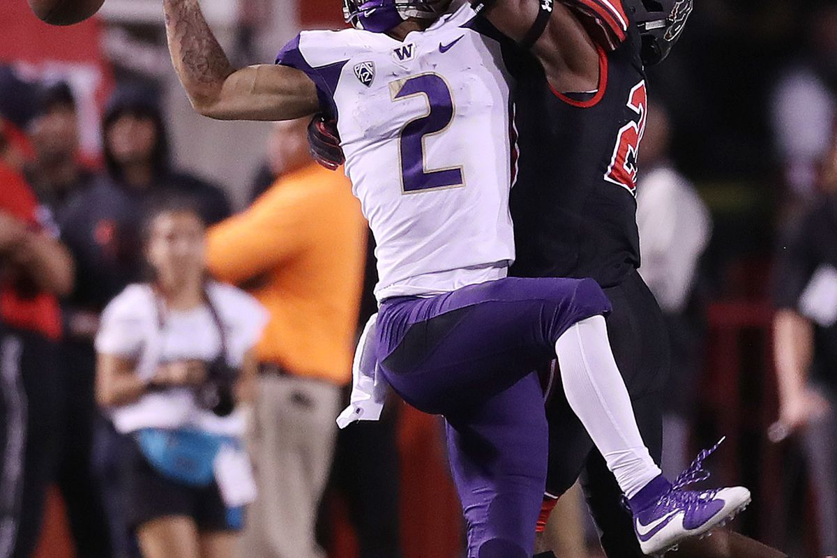 Washington Huskies wide receiver Aaron Fuller (2) and Utah Utes defensive back Javelin K. Guidry (28) compete for the ball during a game at Rice-Eccles Stadium in Salt Lake City on Saturday, Sept. 15, 2018.