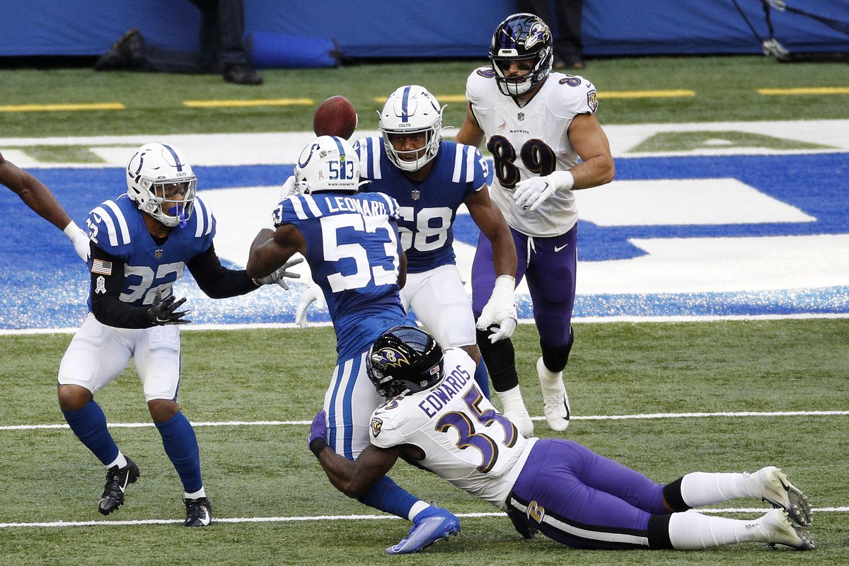 Bobby Okereke #58 of the Indianapolis Colts catches a lateral from teammate Darius Leonard #53 after Leonard picked up a fumble from Gus Edwards #35 of the Baltimore Ravens during the second half at Lucas Oil Stadium on November 08, 2020 in Indianapolis, Indiana.