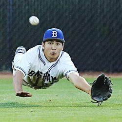 Bingham's Aaron Marsh dives for a long fly ball as Bingham and Pleasant Grove play Wednesday, May 21, 2014 in a 5A one-loss bracket game at Kearns.