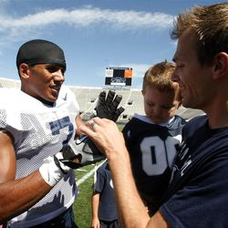 Preston Hadley signs autographs for Jon Bayton and his son Landen after a BYU scrimmage at LaVell Edwards Stadium in Provo on Saturday, Aug. 13, 2011.