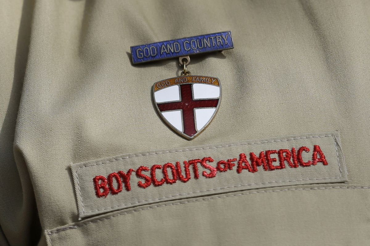 """FILE - In this Feb. 4, 2013 file photo, shows a close up detail of a Boy Scout uniform worn during a news conference in front of the Boy Scouts of America headquarters in Irving, Texas. The Boy Scouts of America says it is exploring """"all options"""" to addre"""