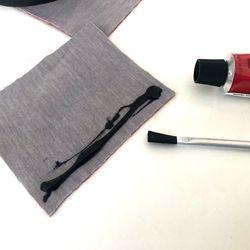 <em>Spread neoprene glue (or prepare sewing materials).</em>