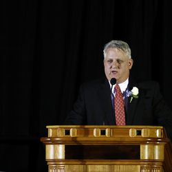 Jimmy Edwards, son of LaVell Edwards, speaks a public memorial service for former BYU football coach LaVell Edwards at the Provo Convention Center on Friday, Jan. 6, 2017.