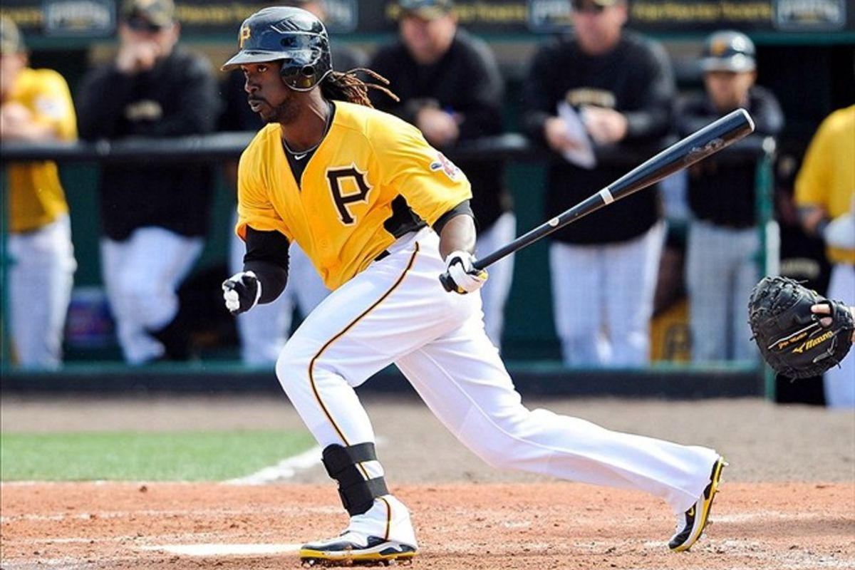 Mar 4, 2012; Bradenton, FL, USA; Pittsburgh Pirates center fielder Andrew McCutchen (22) lines the ball to third base during the fifth inning against the Toronto Blue Jays at McKechnie Field. Mandatory Credit: Jerome Miron-US PRESSWIRE