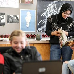 Katherine Berensen, 13, left, Stella Bradley, 13, Myya Min, 18, and Laila Reyes, 18, hang out and study in the Our CASA space at West High School in Salt Lake City on Friday, Feb. 24, 2017. Our CASA spaces are part of an initiative to increase access to higher education for first-generation students and their families on Salt Lake City's west side. The younger students are part of the Extended Learning Program that allows middle schoolers to take high school courses.