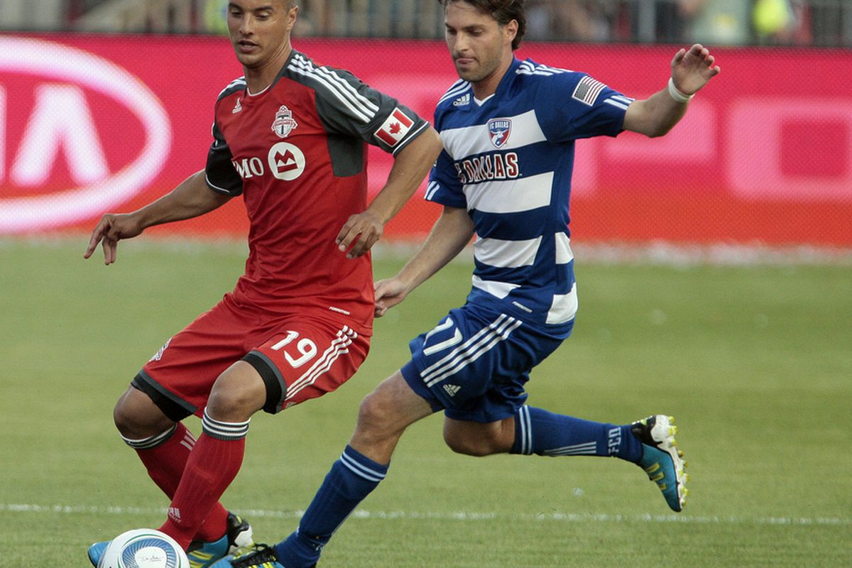 TORONTO, CANADA - JULY 20:  Mikael Yourassowsky #19 of Toronto FC battles for the ball with Ricardo Villar #11 of FC Dallas during MLS action at BMO Field July 20, 2011 in Toronto, Ontario, Canada. (Photo by Abelimages/Getty Images)