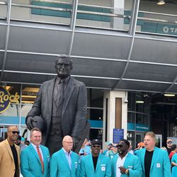 Jason Taylor, John Offerdal, Dick Anderson, Mark Clayton, Mark Duper, and John Giesler in front of the Joe Robbie Statue after the Miami Dolphins Walk of Fame induction ceremony on December 2, 2018 in the Joe Robbie Alumni Plaza at Hard Rock Stadium, Miami Gardens, Florida.