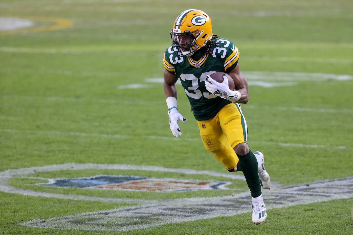 Aaron Jones #33 of the Green Bay Packers runs with the ball in the second quarter against the Tampa Bay Buccaneers during the NFC Championship game at Lambeau Field on January 24, 2021 in Green Bay, Wisconsin.