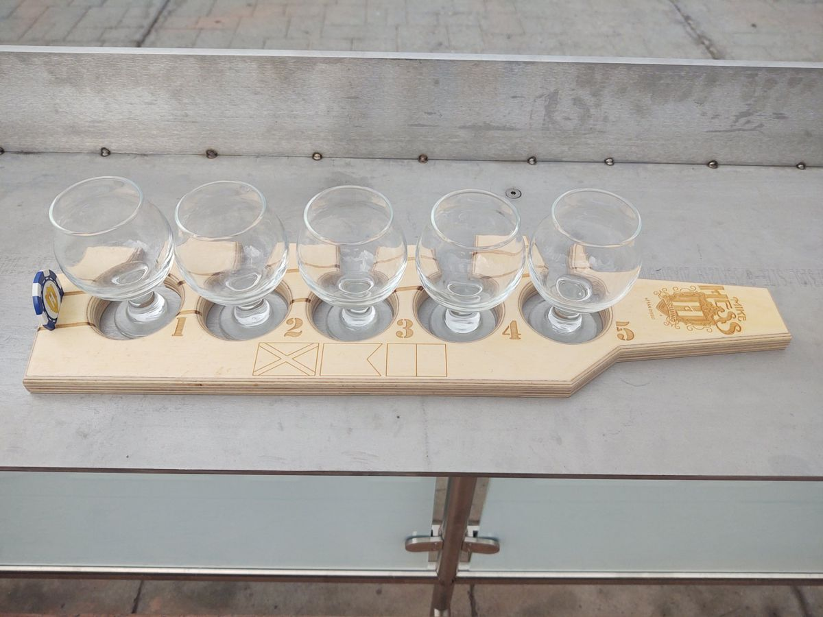 photo of a flight deck-shaped tasting board at Mike Hess Brewing