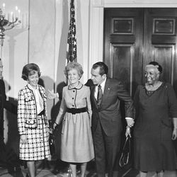 President Richard Nixon and Pat Nixon line up with their guests after a White House church service in Washington on Jan. 24, 1971, that featured gospel singer Ethel Waters, right. With them are Eugene T. Goffin and his wife. Goffin, who conducted the service, is minister of Nixon's Quaker church in Whittier, California. (AP Photo/HWG)