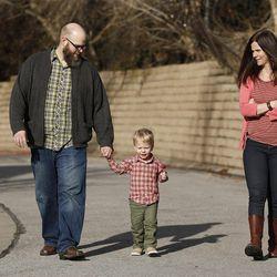 Blair Christensen and Kristan Warnick walk with their son Seth in Salt Lake City Thursday, Jan. 21, 2016.