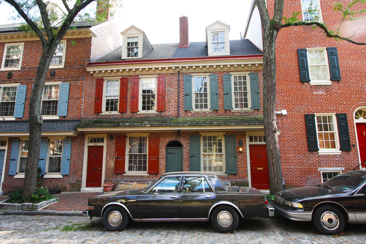 A series of brick colonial rowhouses in Philadelphia.