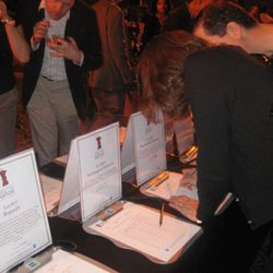A silent auction featured tasting dinners donated by restaurants like Rogue 24 and Kushi, baseball tickets and more.