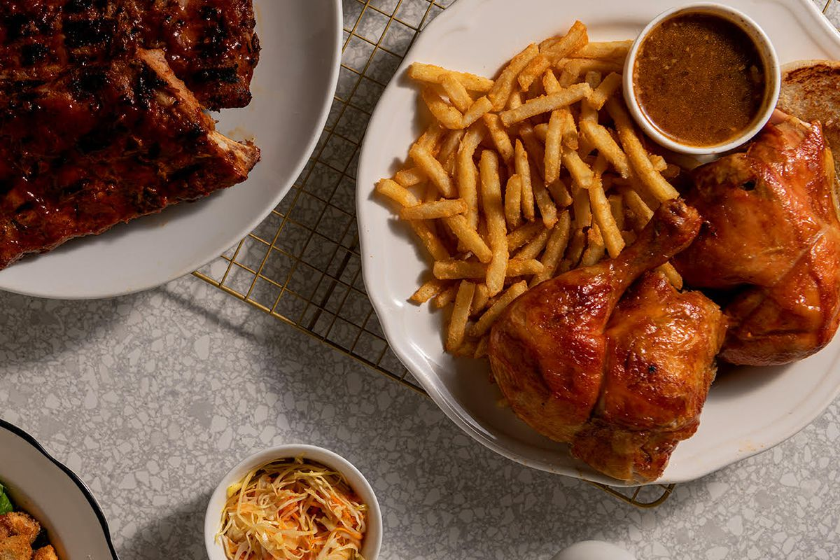 plate of chicken with fries