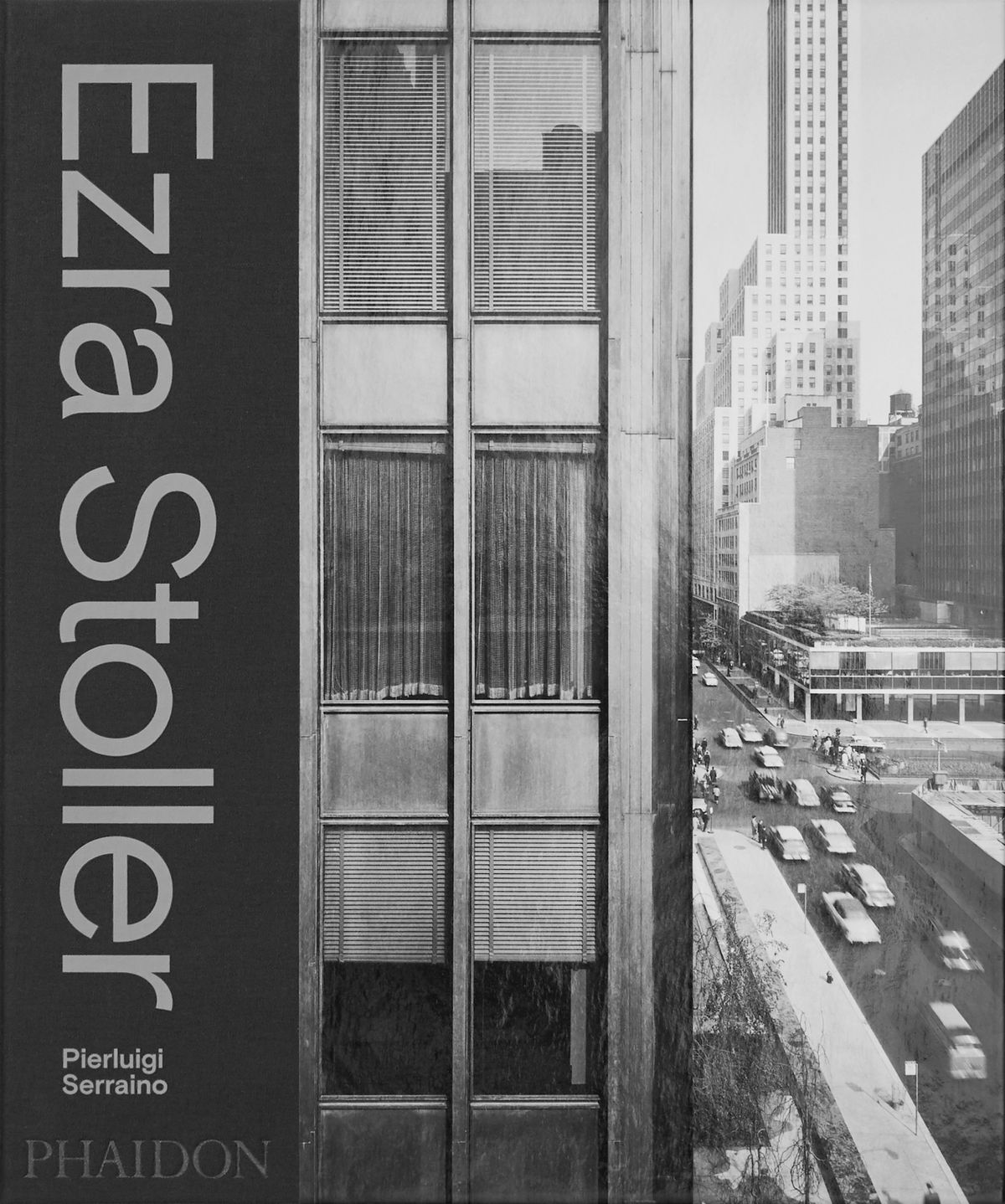 A book cover showing a black-and-white photograph of a New York City building's windows with a streetscape in the distance.