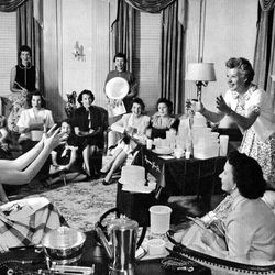 This 1950's photo courtesy of the Smithsonian Archives Center, National Museum of American History Brownie Wise shows Brownie Wise as she tosses a bowl filled with water at a Tupperware party. Tupperware, it seems, is enjoying a renaissance 65 years after it first hit the market with Wonder Bowls, Bell Tumblers and Ice-Tup molds for homemade frozen treats.