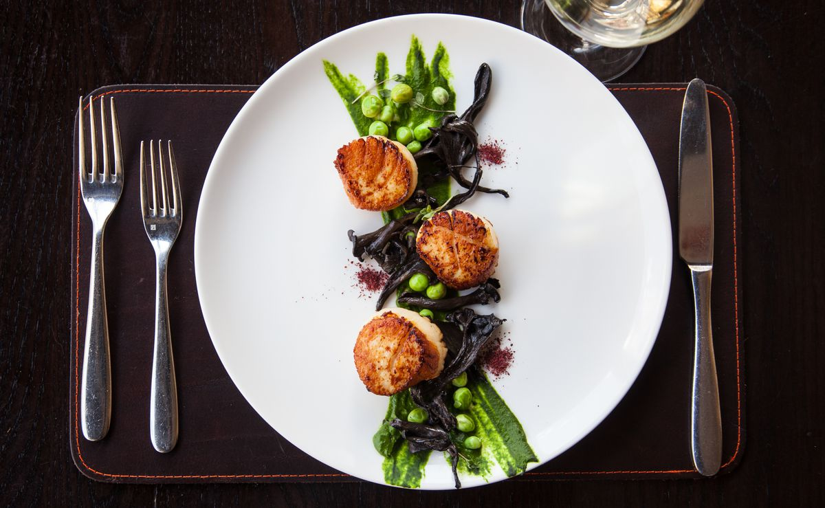 scallops and greens on a plate