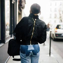 Woman wearing head-to-toe Vetements on her way to a show.