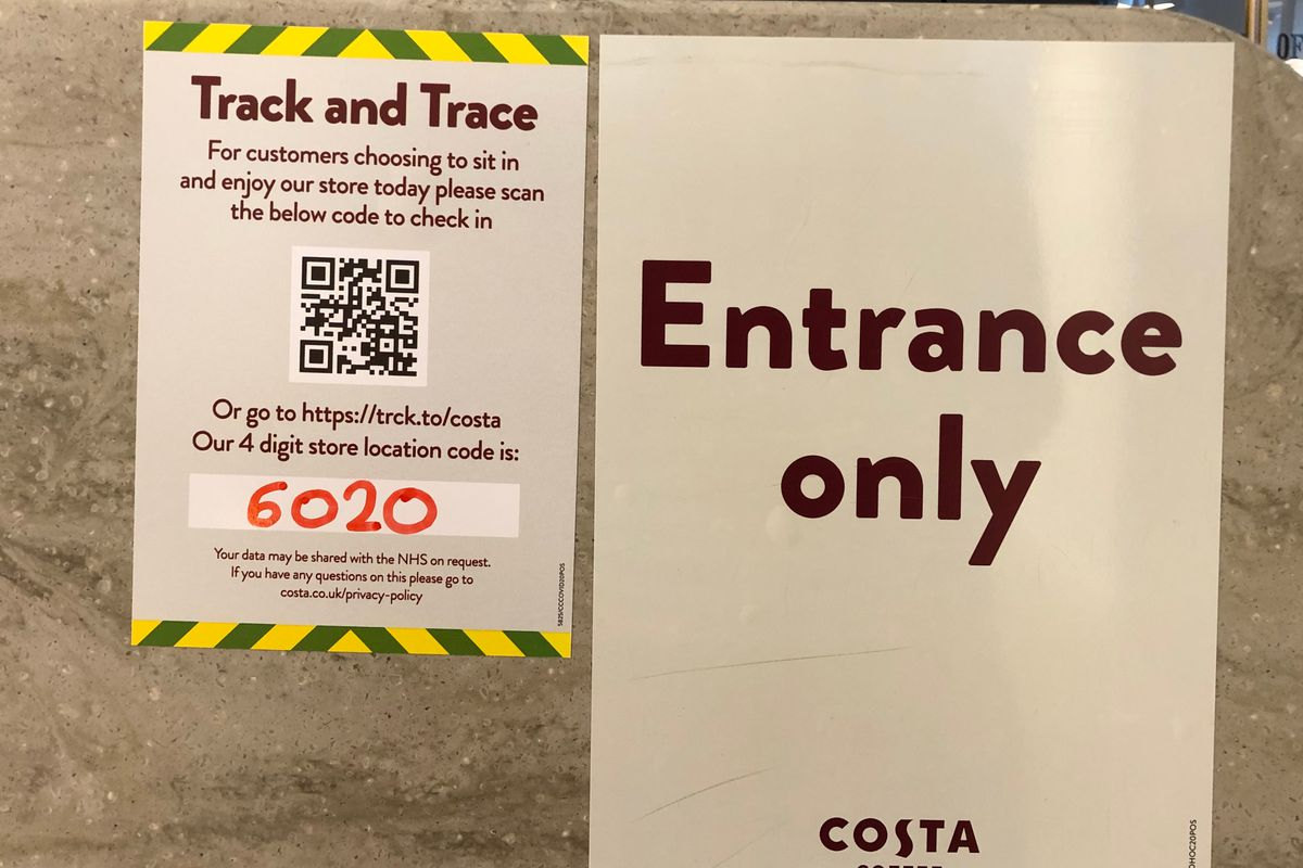 UK, July 18, 2020. Customer notice at the entrance of a coffee shop explaining how they can use the Track and trace to ensure they are informed of coronavirus infection