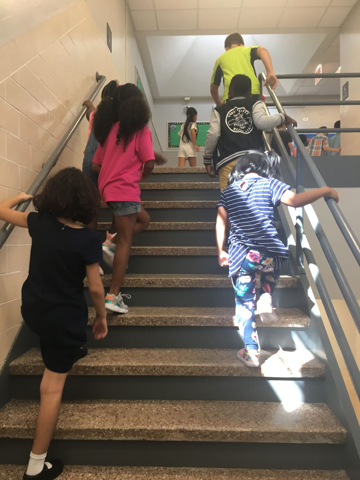 A gut rehab meant fresh new paint and lockers, but the marble staircase remains