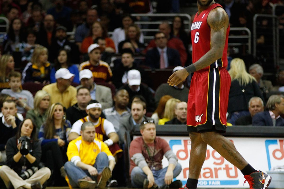 LeBron watches his back during a visit to Cleveland last season.