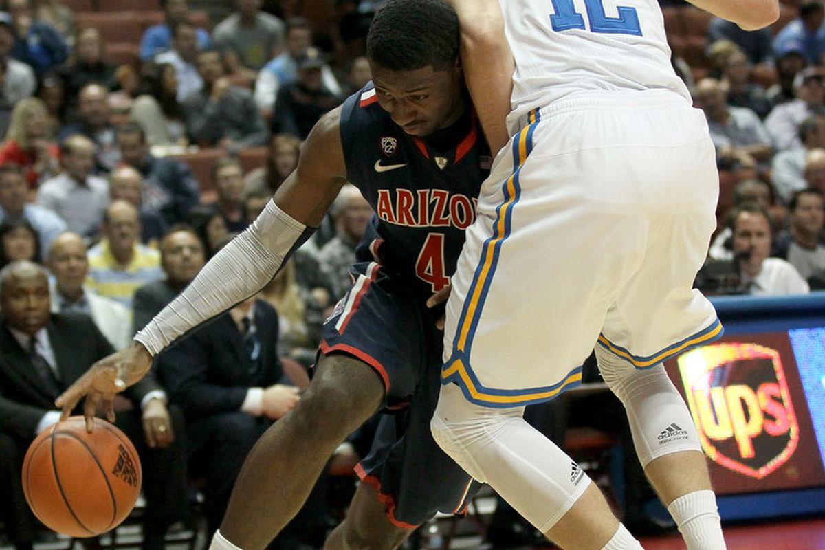 ANAHEIM, CA - JANUARY 05: Solomon Hill #44 of the Arizona Wildcats drives against David Wear #12 of the UCLA Bruins at the Honda Center on January 5, 2012 in Anaheim, California. (Photo by Stephen Dunn/Getty Images)