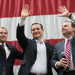 Utah Gov. Gary Herbert, left, joins GOP presidential candidate and Texas Sen. Ted Cruz, center, and Sen. Mike Lee, R-Utah, on stage at a rally in Draper at the American Preparatory Academy Saturday, March 19, 2016.