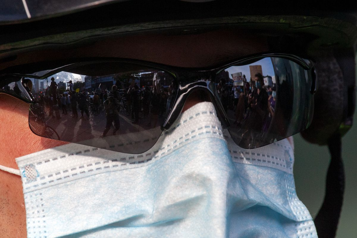 An NYPD officer keeps watch over protesters outside the Barclays Center in Brooklyn on May 29.