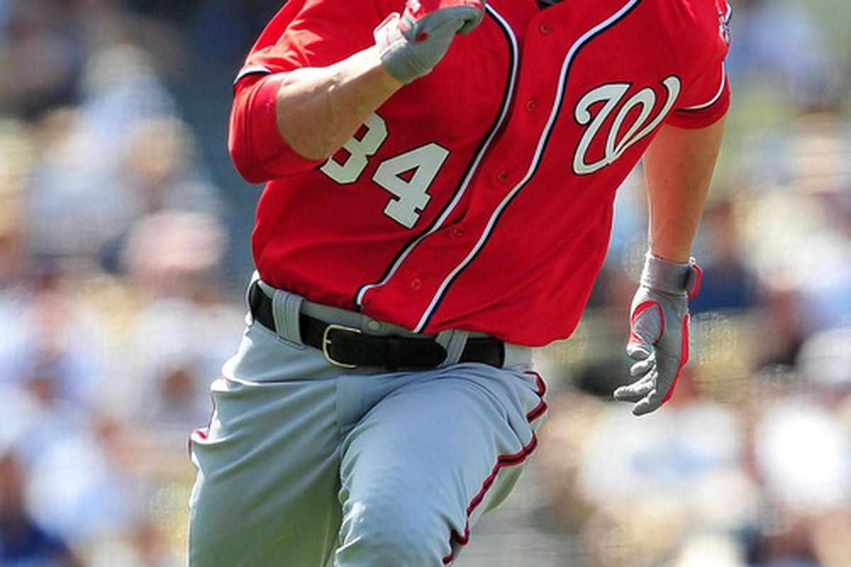 April 29, 2012; Los Angeles, CA, USA; Washington Nationals right fielder Bryce Harper (34) runs to first after he hits a single in the seventh inning against the Los Angeles Dodgers at Dodger Stadium. Mandatory Credit: Gary A. Vasquez-US PRESSWIRE
