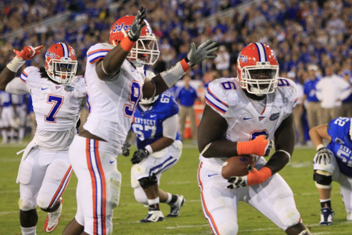 Defensive tackle Jaye Howard grabs a fumble and heads to the end zone to put Florida ahead 28-3 in the second quarter. [Associated Press]