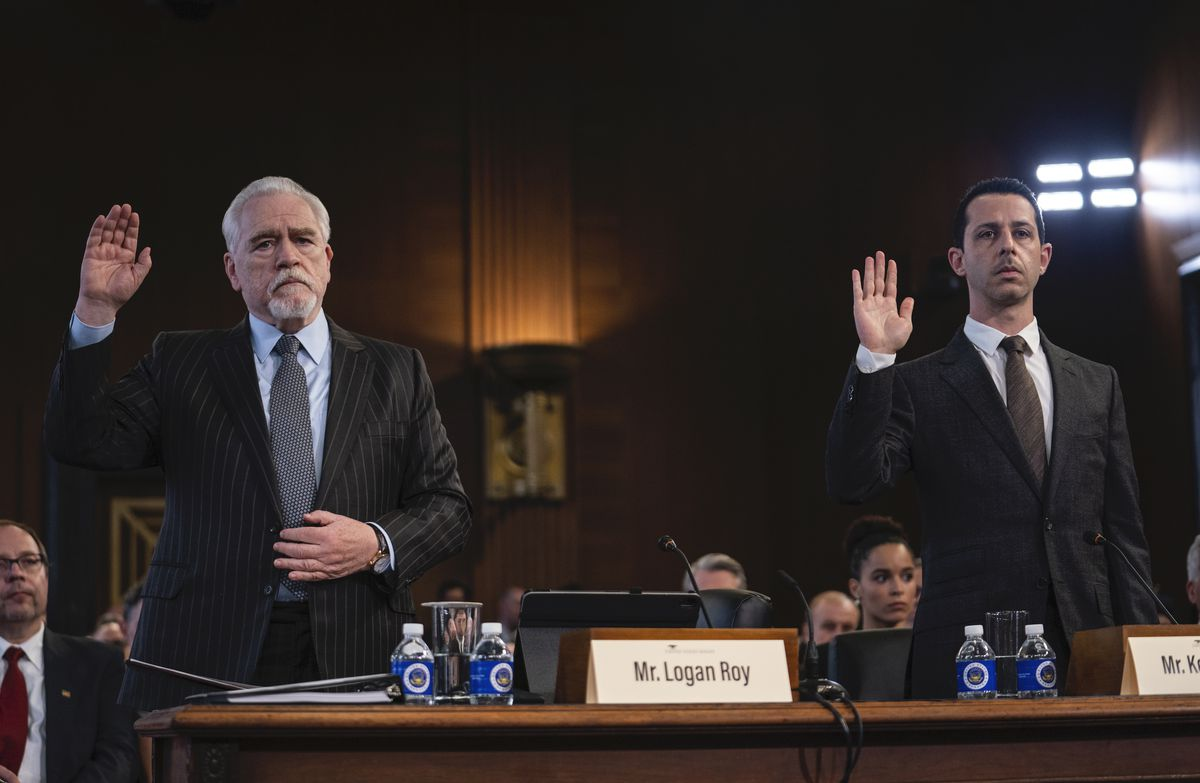 """Logan (Brian Cox) and Kendall (Jeremy Strong) testify before Congress in a screenshot from Succession season 2, episode 9, """"DC."""""""