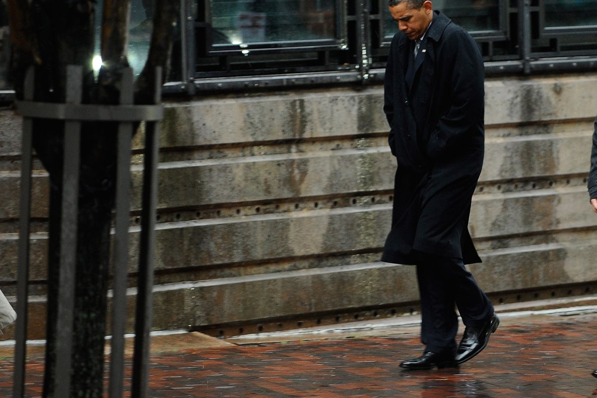 President Barack Obama looks down after after meeting with Victoria Reggie Kennedy, the widow of Sen. Edward Kennedy (D-MA).