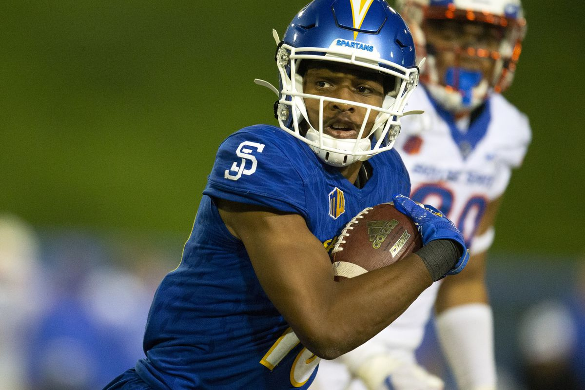 San Jose State wide receiver Tre Walker carries the ball against Boise State during the second quarter of a football game at CEFCU Stadium.