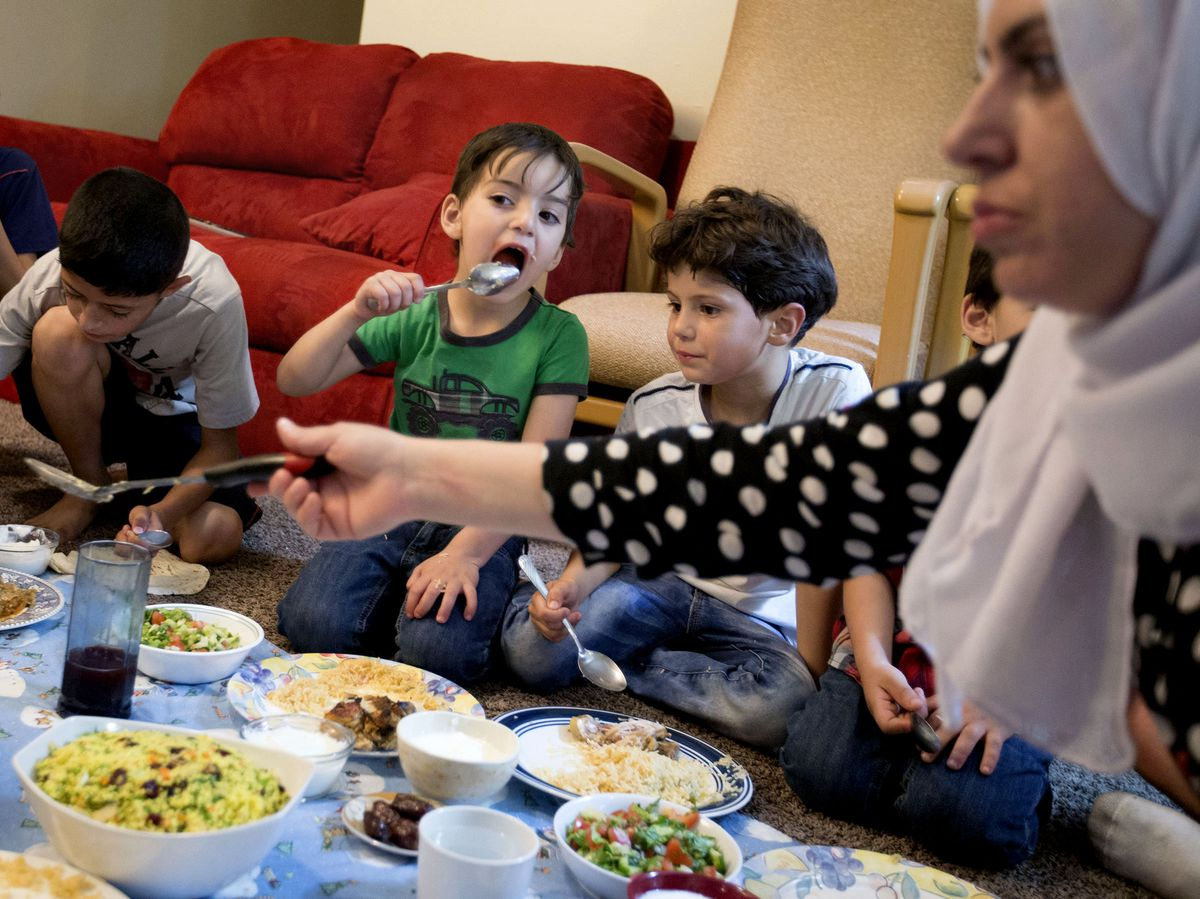 Rasha Hredeen, right, and her children and nephews eat iftar during the month of Ramadan at the Hredeen home in Millcreek on Tuesday, June 6, 2017.