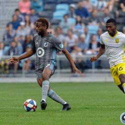 July 10, 2019 - Saint Paul, Minnesota, United States - Minnesota United midfielder Kevin Molino (7) dribbles the ball as New Mexico United midfielder Saalih Muhammad (16) gives chase during the quarter-final match of the US Open Cup at Allianz Field.