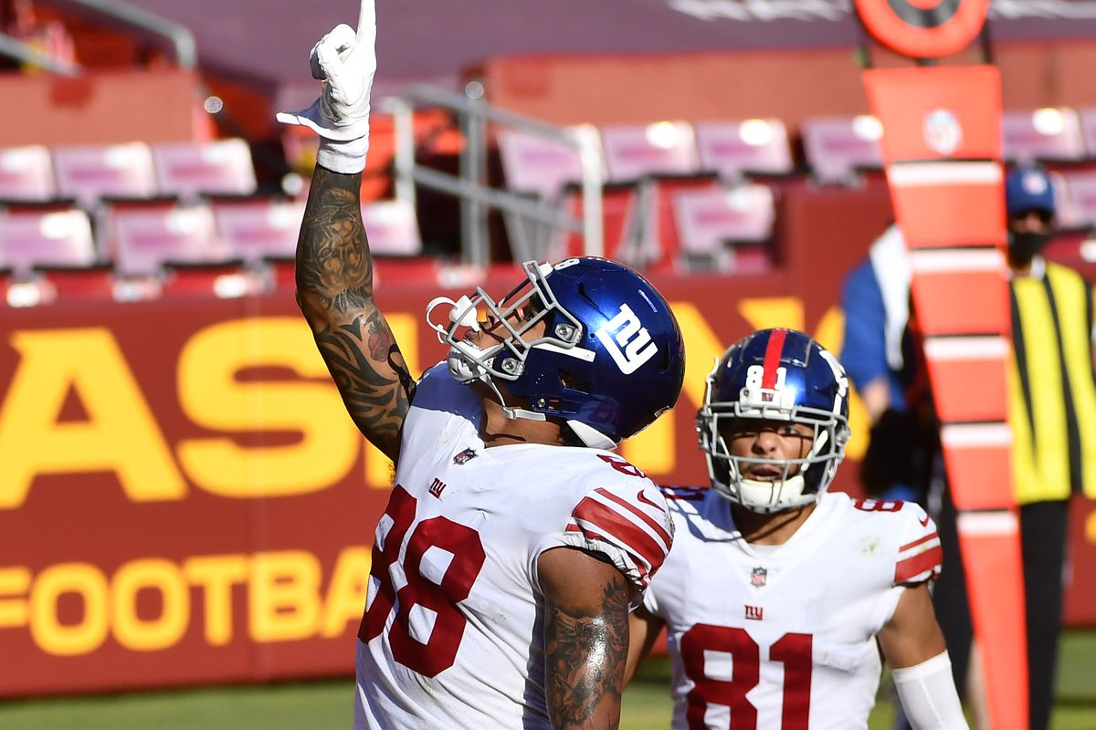 New York Giants tight end Evan Engram (88) reacts after scoring a touchdown against the Washington Football Team during the second quarter at FedExField.