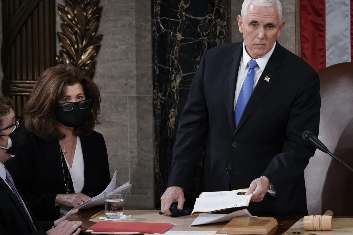 In this Jan. 6, 2021, photo, Senate Parliamentarian Elizabeth MacDonough, second from left, works beside Vice President Mike Pence during the certification of Electoral College ballots in the presidential election, in the House chamber at the Capitol in Washington.